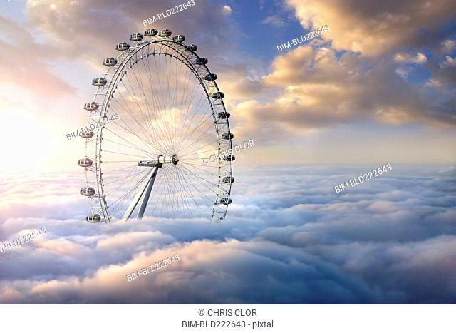 Ferris wheel above clouds