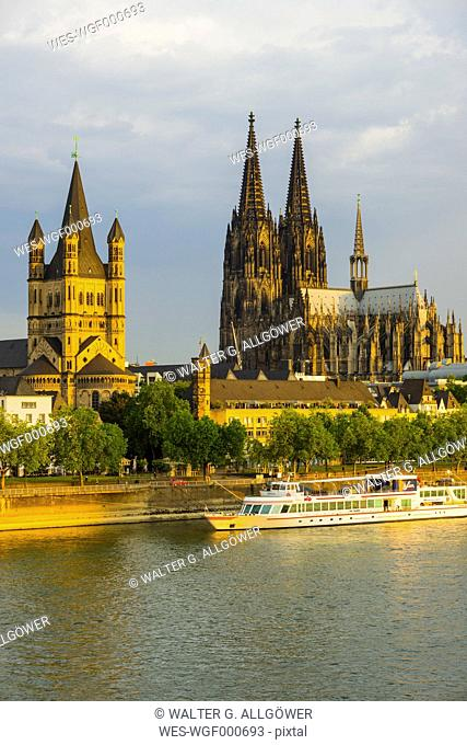 Germany, Cologne, View to Great St Martin, Cologne dome, Old town riverside, Rhine river in the evening