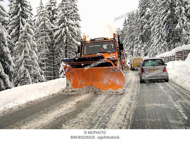 snowplow on winterly country road