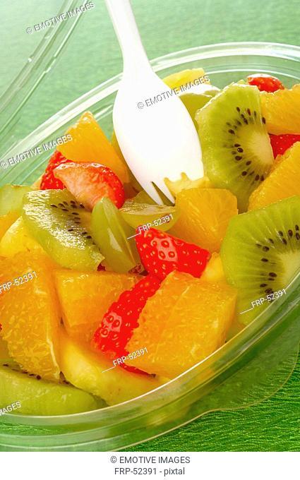Fruit salad in a plastic bowl