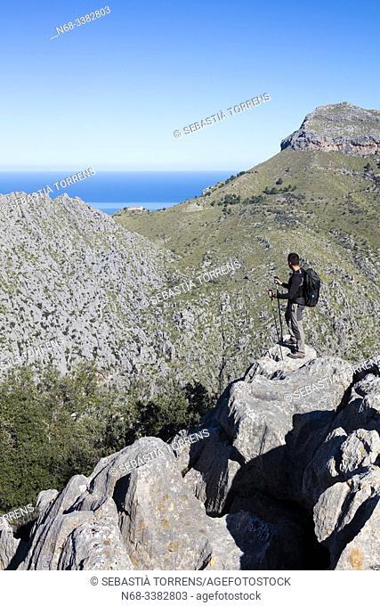Hiker in Serra de Tramuntana, Escorca, Mallorca, Spain