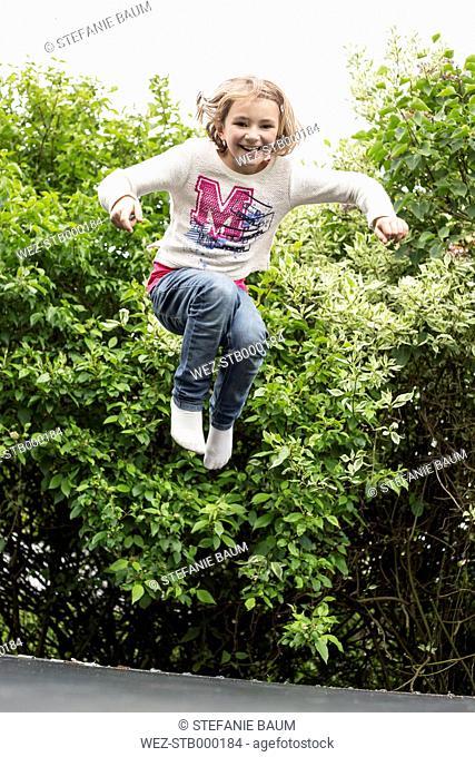 Little girl jumping on trampoline