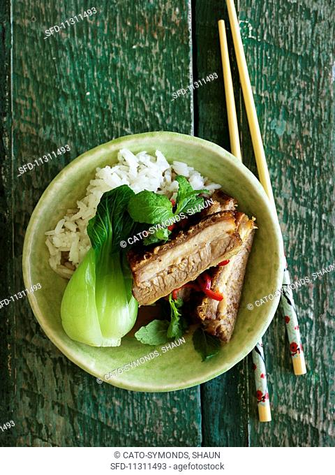 Spicy pork belly with chilli peppers, bok choy and rice (Asia)