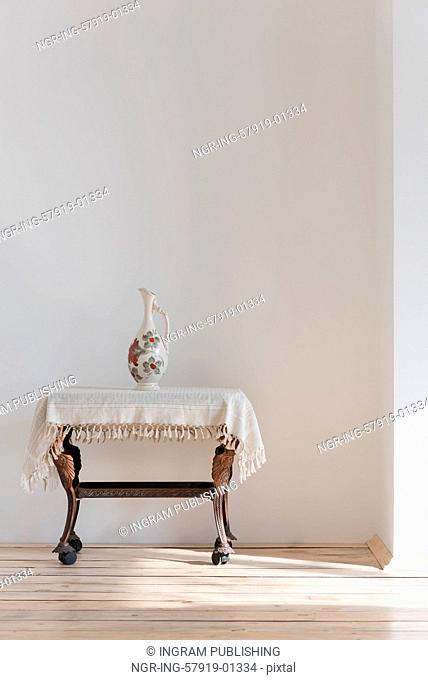 Vintage table and vase in sunlight
