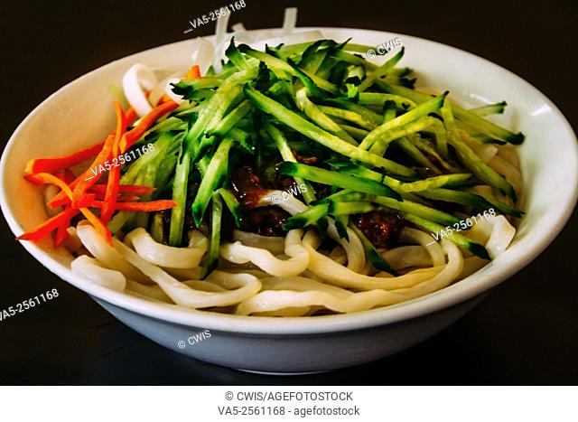 Bejing, China - The view of a bowl of noodles served with thick gravy