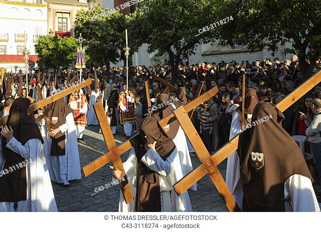 Penitents with cross at the Semana Santa (Holy Week) of Seville. Seville province, Andalusa, Spain