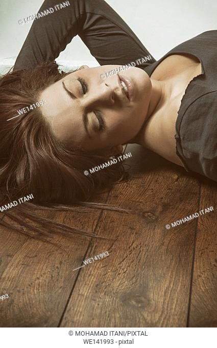 Stressed woman laying on the floor