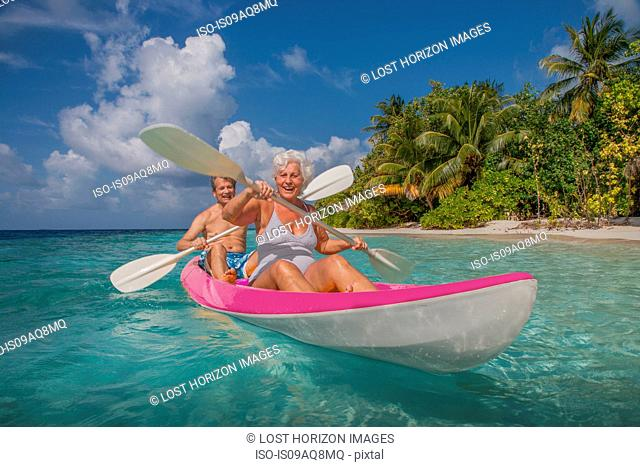 Senior couple in canoe, Maldives