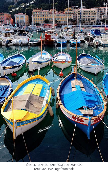 Fishingboats in the port of Nice with houses in the background, South France, Europe