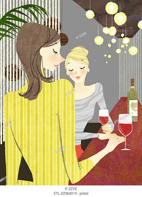 Two Woman with wine at bar counter