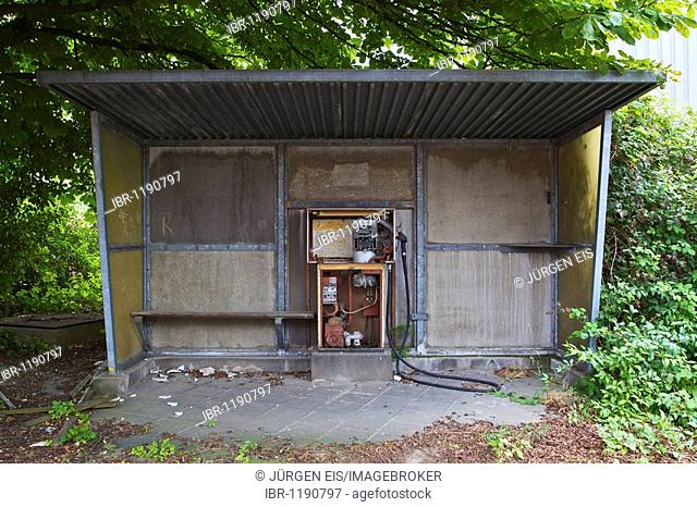 Uncovered gas pump in a small shelter on the factory premises of the former Deutsche Norton GmbH, manufacturer of abrasive material, Wesseling