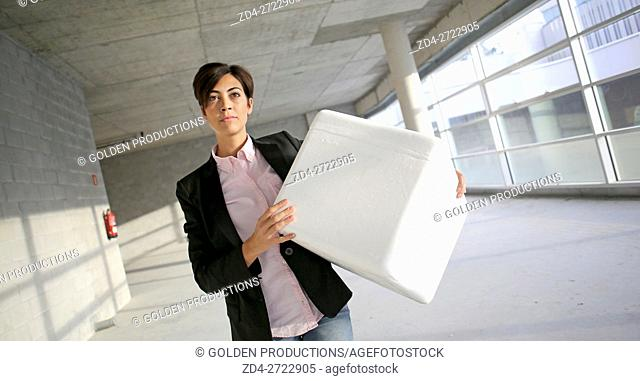 Executive woman carrying package