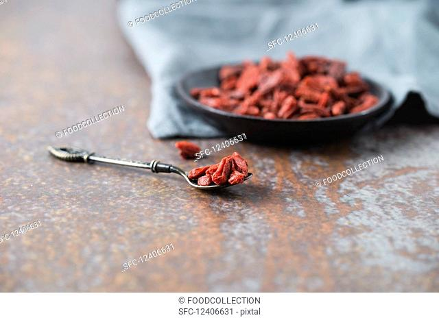 Dried goji berries in a bowl and on a spoon