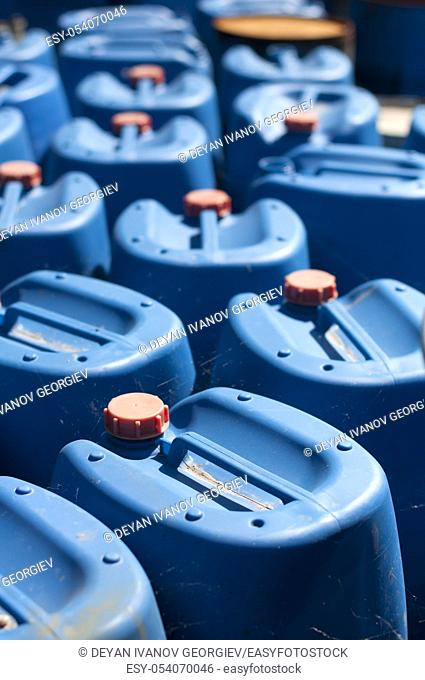 Ordered old blue canisters for oil products