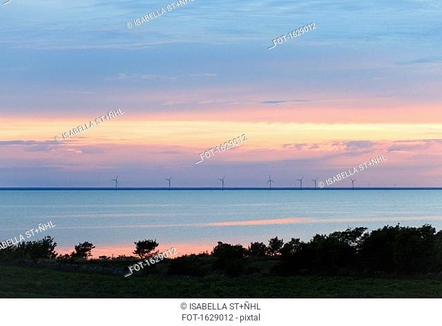 Scenic view of sea against cloudy sky during sunset, +ûland, Sweden