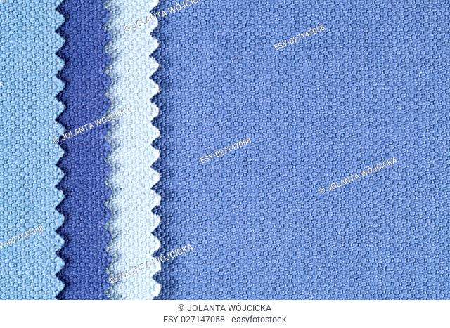 Composition of colored vertical stripes of serrated cotton fabric, place for text