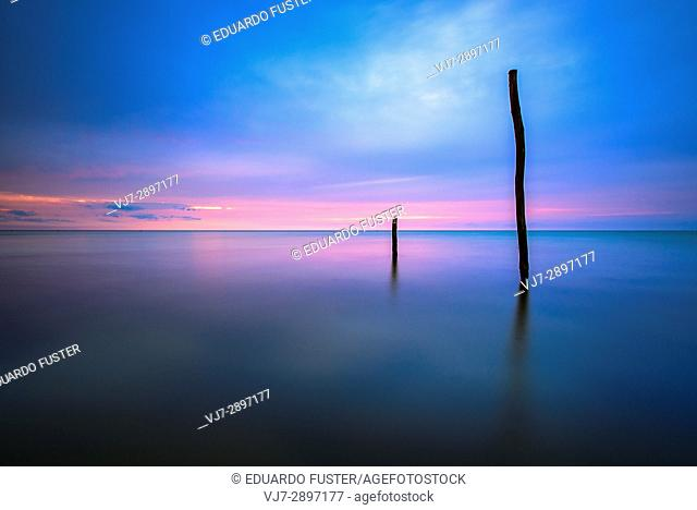 Dock in a beach of Isla Holbox at sunset, Quintana Roo (Mexico)