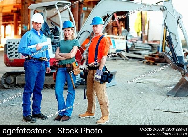 group of construction workers looking at camera standing in fron