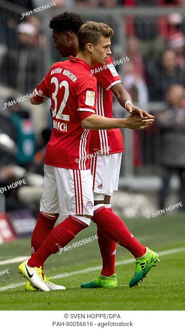 Munich's David Alaba (R) is substituted for Joshua Kimmich (L) during theGerman Bundesliga soccer match between BayernMunich and FSVMainz 05 in the Allianz...