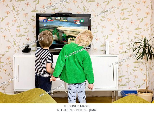Boys playing video games, Sweden