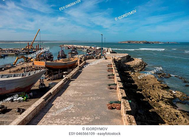 View to fishing boats in Essaouira harbour and cannons in Skala du Port ( Northern Skala ), Morocco
