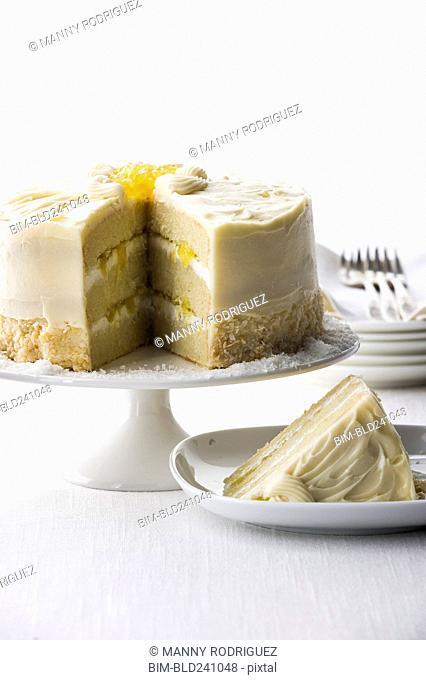 Slice of coconut cream cake on plate