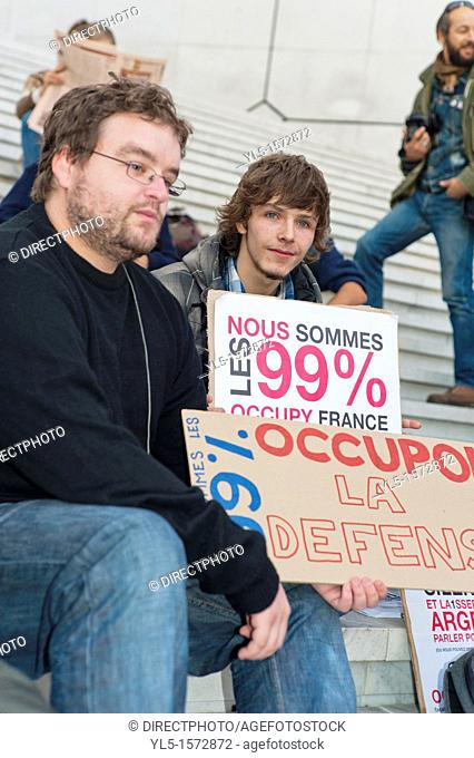 Paris, France, Occupy La Défense Demonstration, Activist Occupant Holding Protest Signs, on Parvis, Indignant Movement
