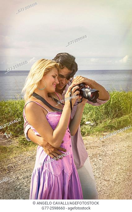 Miami Beach. Florida. Usa. Couple watching picture in the camera