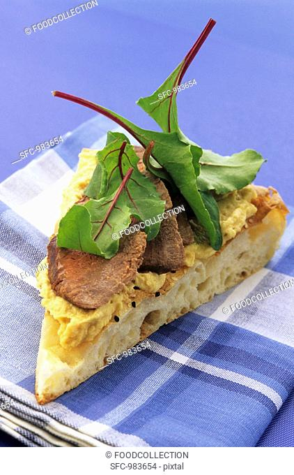Flat bread with hummus and meat