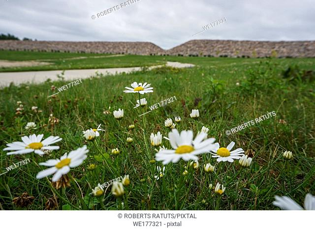 Scenery of stones and meadow in Koknese in the park Garden of Destinies in Latvia. Garden of Destinies is a monumental architectural ensemble on the Daugava...