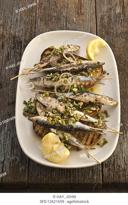 Grilled sardines with green herbs and almonds