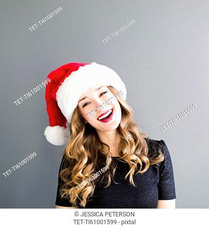 Studio portrait of woman wearing Santa hat