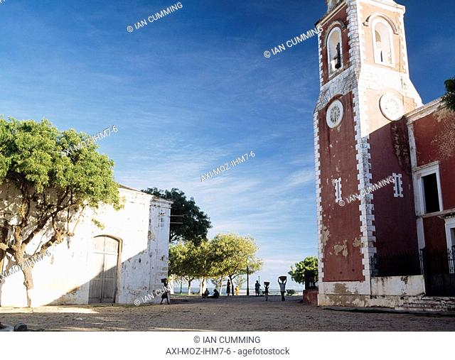 Silhouette of women carrying buckets on their head through S in front of the Chapel of Sao Paulo, Ilha de Mocambique, Mozambique