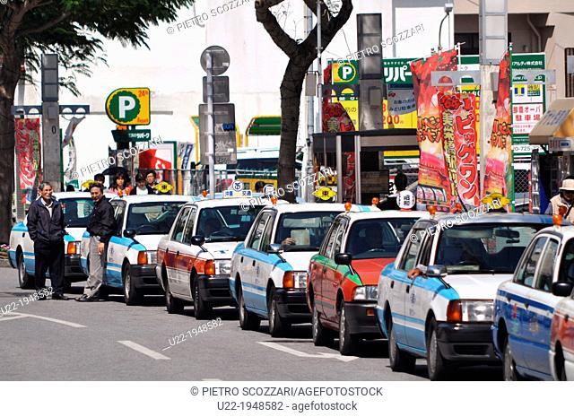 Naha, Okinawa, Japan, long line of taxis along Okiei-dori, on Sunday