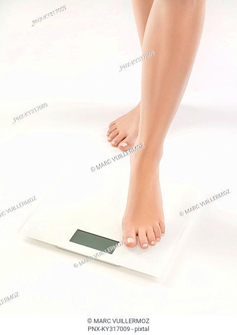 Woman on bathroom scale