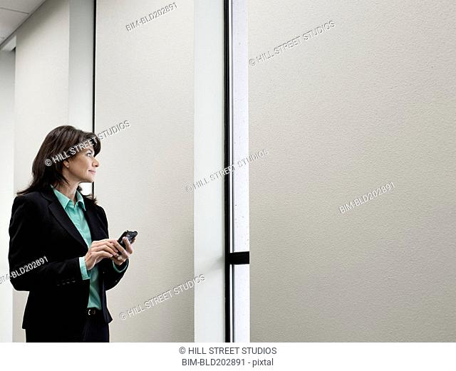 Caucasian businesswoman using cell phone