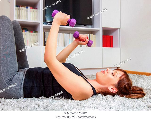 Fitness Young Woman Exercising at home. Healthy lifestyle concept