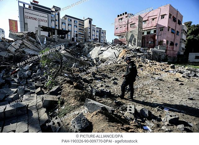 26 March 2019, Palestinian Territories, Gaza City: A security officer inspects a destroyed Hamas site, after strikes carried out by the Israeli army