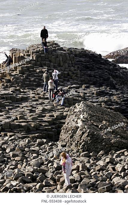 Group of tourists at coast, Giants Causeway, Northern Ireland, UK