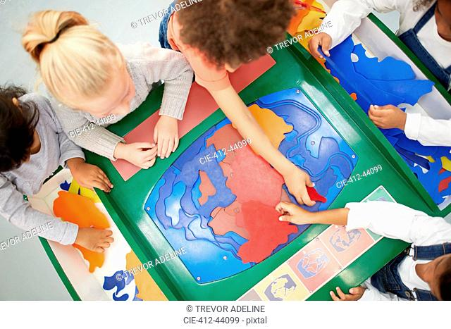 View from above kids playing at interactive exhibit in science center