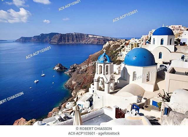 Set against the blue waters of the Aegean Sea (also referred to as the Caldera) is the blue-domed Catholic Church of Agios Spyridonas and, behind it