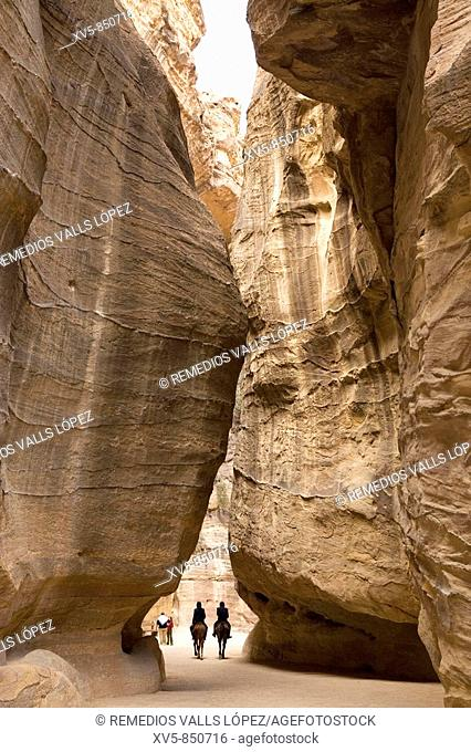 Jordan, Petra, the Siq Entrance to the city is through the Siq, a narrow gorge, over 1 kilometre in length, which is flanked on either side by soaring