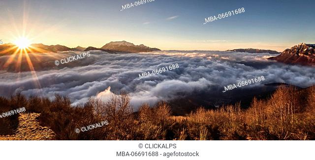 Italy, Lombardy, Como district. Como Lake,Clouds carpet, dawn,mount grona