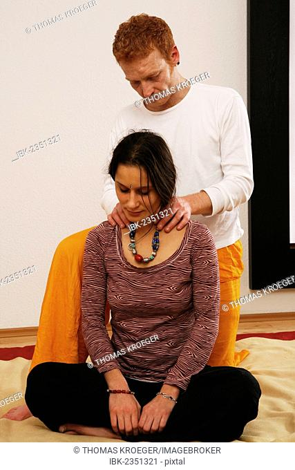 Young woman doing relaxation exercises with a Qigong coach
