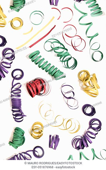 Mixed colorful streamers on a white background