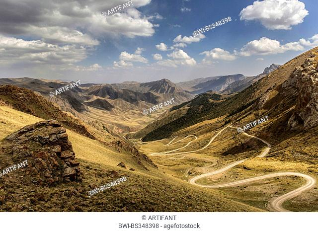 view from Lake Song-Kul plateau to serpentines in mountain scenery, Kyrgyzstan, Naryn