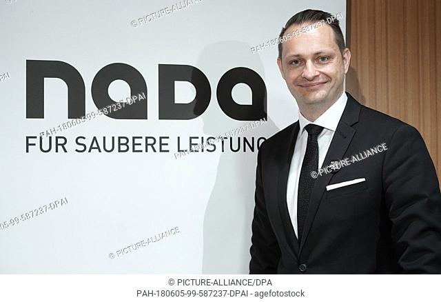 05 June 2018, Germany, Berlin: The chairman of the German National Anti-Doping Agency (NADA), Lars Mortsiefer, stands next to the logo during the financial...