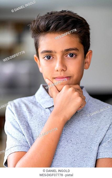 Portrait of a confident boy at home