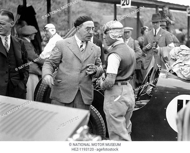 Tazio Nuvolari at the Ulster TT race, 1933. Tazio Nuvolari engaged in conversation with Hugh McConnell, the race organiser