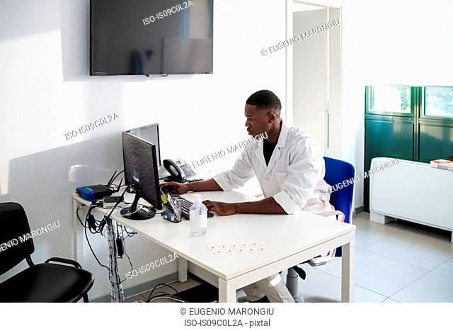 Doctor working on computer in hospital